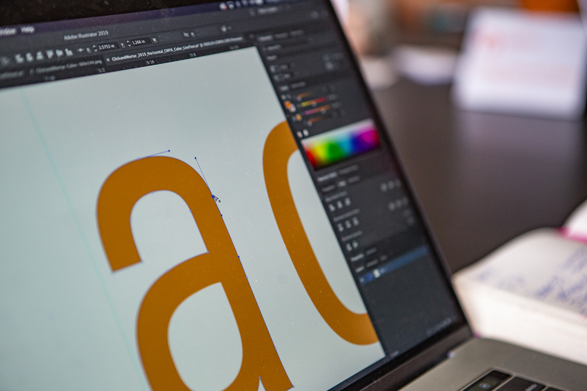 Letter A with pen tool being used in Adobe Illustrator