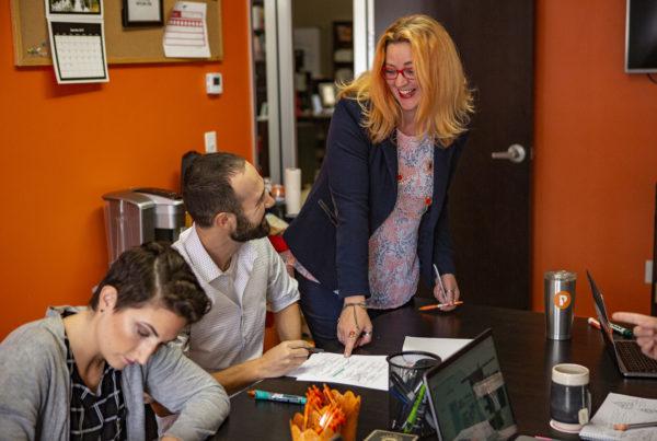 Peppershock Ad Agency three people engaging